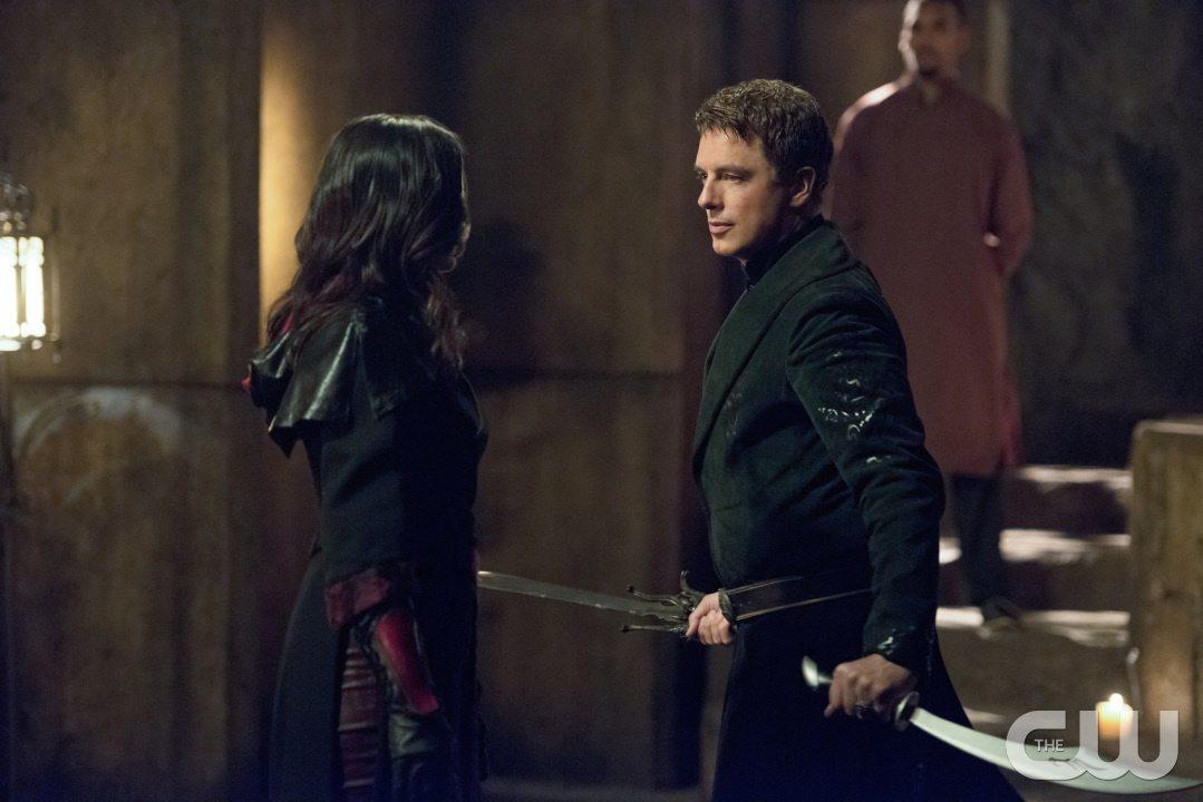 "Arrow -- ""Restoration"" -- Image AR403B_0071b.jpg -- Pictured (L-R): Katrina Law as Nyssa al Ghul and John Barrowman as Malcolm Merlyn -- Photo: Diyah Pera /The CW -- �© 2015 The CW Network, LLC. All Rights Reserved."