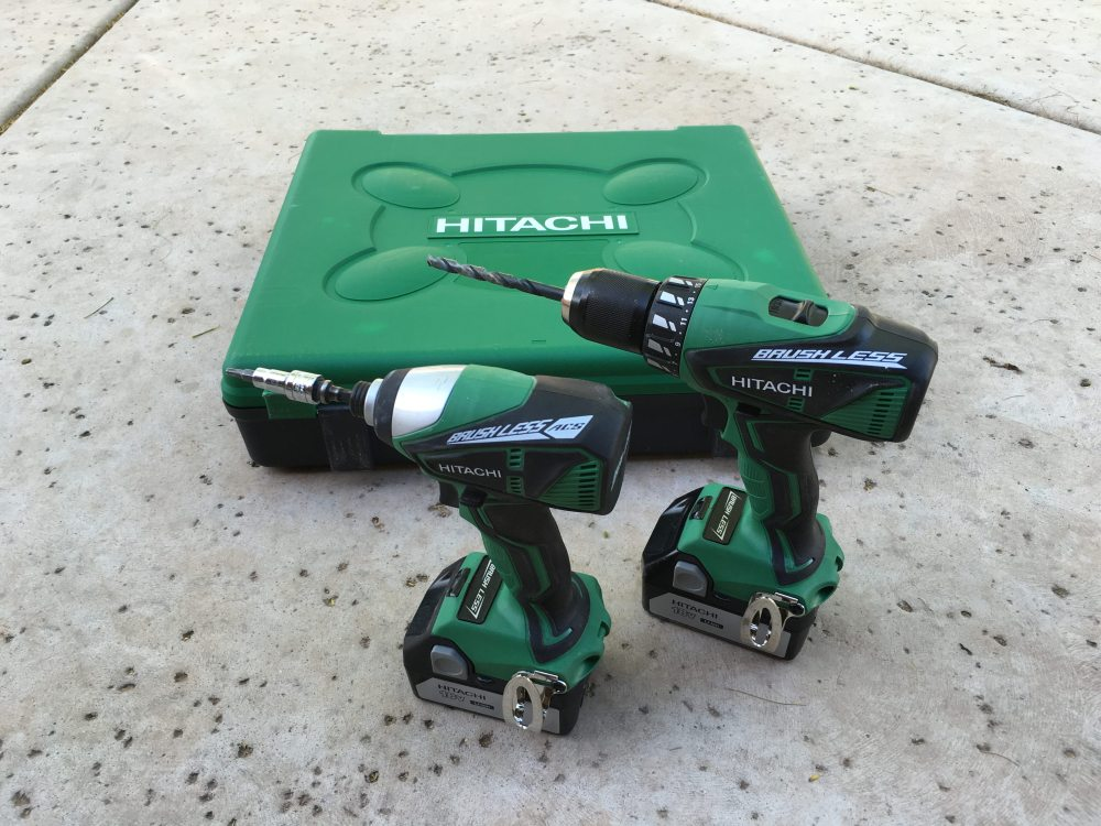 Two cordless drills and a carrying case, all green in color