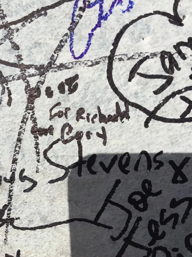 I wrote a note to my brother on the Daytona Speedway finish line. Photo copyright Corrina Lawson