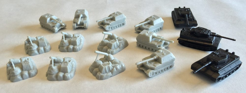 Close up of 3 different Memoir '44 Equipment Pack units, the tanks having been spray painted black.