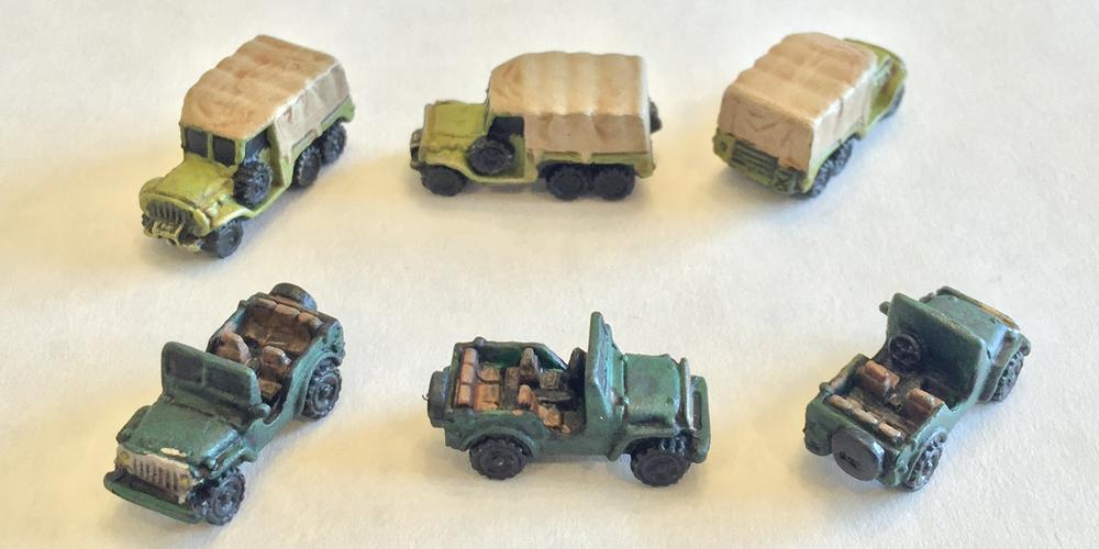 Fully painted supply trucks and jeeps from Memoir '44.