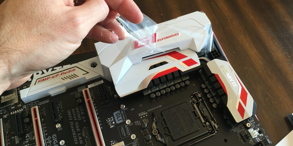 Removing the protective film from the plastic bling parts of the motherboard