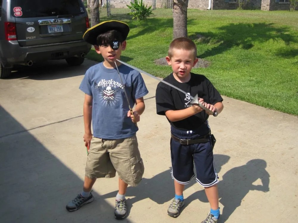 T' lads put on their favorite (read: their only fittin') pirate t-shirts and brought their toy cutlass, eye patches n' hats. Photo: Patricia Vollmer