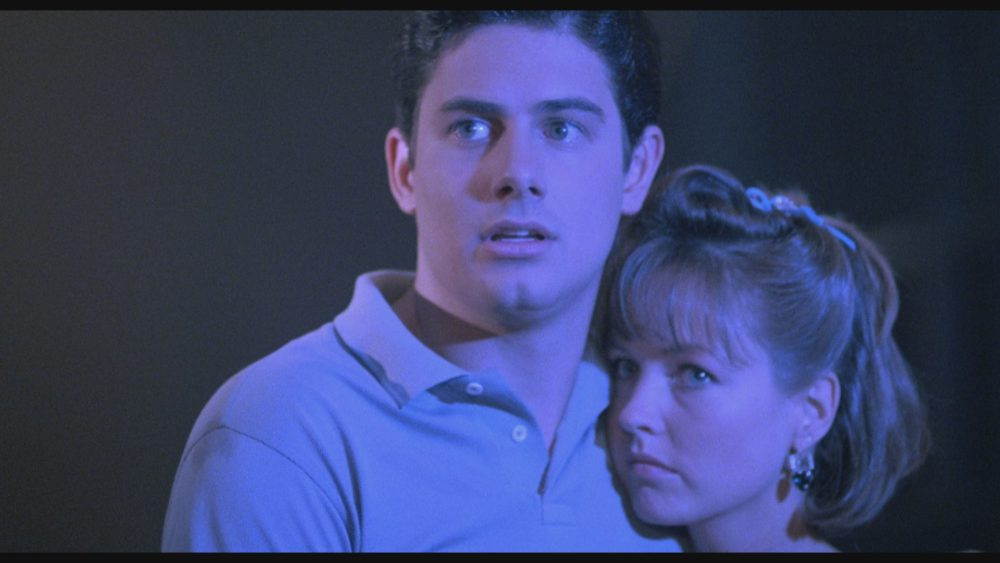 "From left to right: Zach Galligan (""Mark,"" left) and Deborah Foreman (""Sarah,"" right) star in Lionsgate Home Entertainment's WAXWORK."