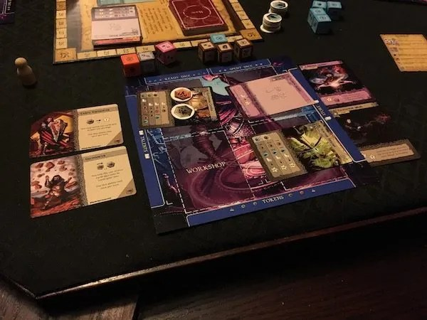 Player Mat populated with cards and dice during a game of Manaforge