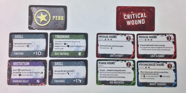A close-up of four perk cards and four critical wound cards.