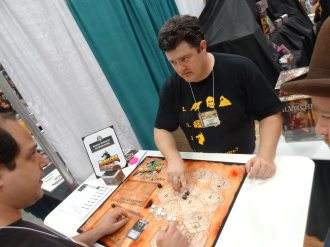 Chris Schreiber at Tasty Minstrel Games runs a demo of Dungeon Roll, a press-your-luck dungeon delve that currently has the record for most Kickstarter backers for a tabletop game.