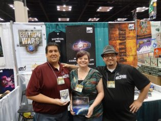 David Villegas, Krista Witt (designer of Eons), and Christopher Witt at the Gamer Nation Studios booth.