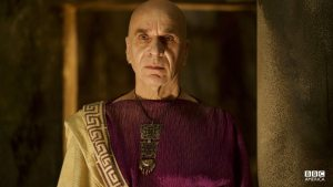 A High Priest in the Temple of Poseidon, Melas is a trusted ally of the Oracle.