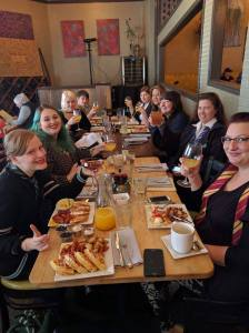 Wizarding Brunch attendees seated at table enjoying brunch