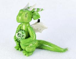 August birthstone dragon with peridot gem