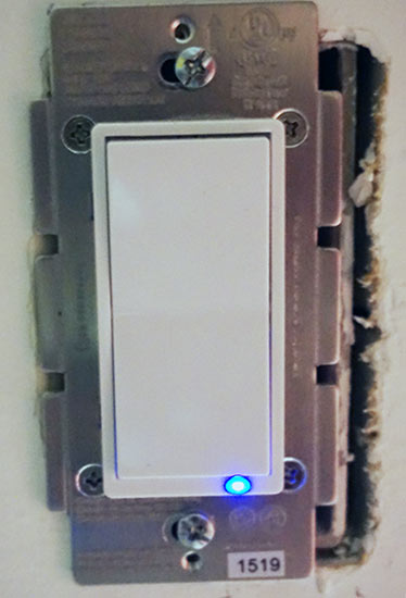 ge_in_wall_smart_switch_installed_lit_up
