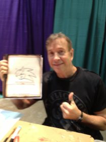 Artist Arthur Suydam with the free sketch he did for my youngest daughter.