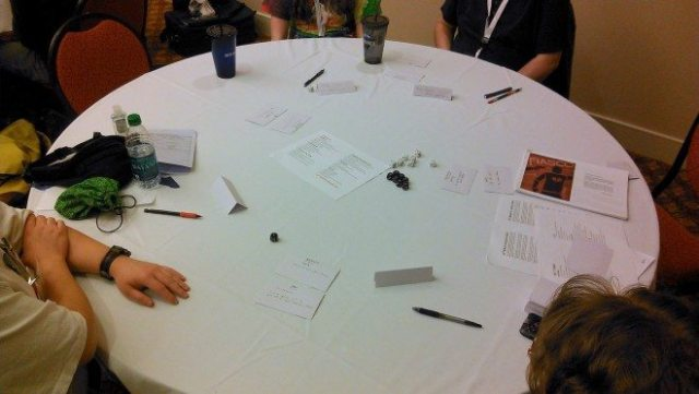 A group of RPG players gathered to play the New Station scenario of Fiasco at GameStorm.