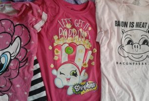 "Three t-shirts. One is the face of Pinky Pie. One is of the Shopkin ""Poppy Corn."" The last has a pig that says ""Bacon Is Meat Candy"" and the website baconfreak.com. All three shirts are pink."