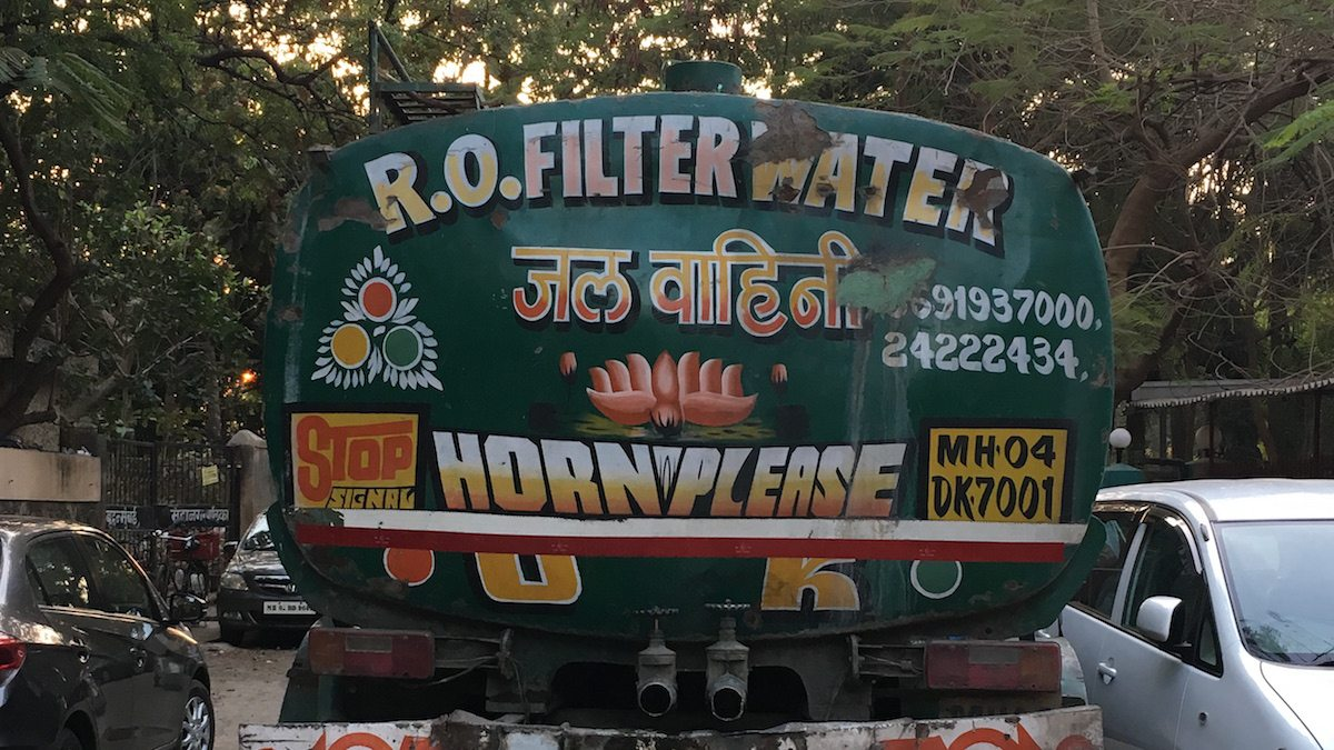 """Back of truck in India where car horn is frequently used. """"Horn OK Please"""" is common site."""