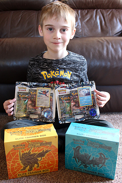 My Pokemon fan with his Ultra Prism haul, Image: Sophie Brown