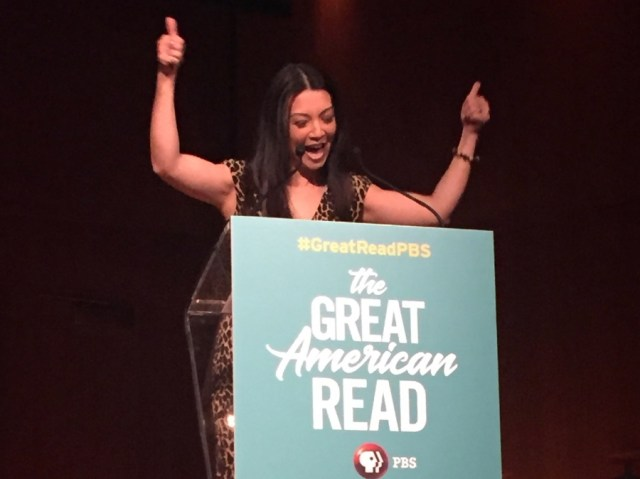 a photo of Ming-Na Wen at the Great American Read announcement giving two thumbs up