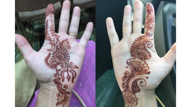 hands with henna designs drawn on