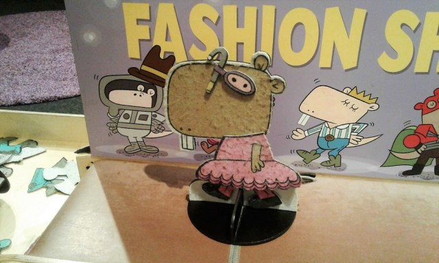Naked Mole Rat character cutout wearing a frilly dress with pants and swim goggles