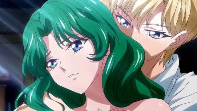 a green haired girl leans against a blonde androgynous figure