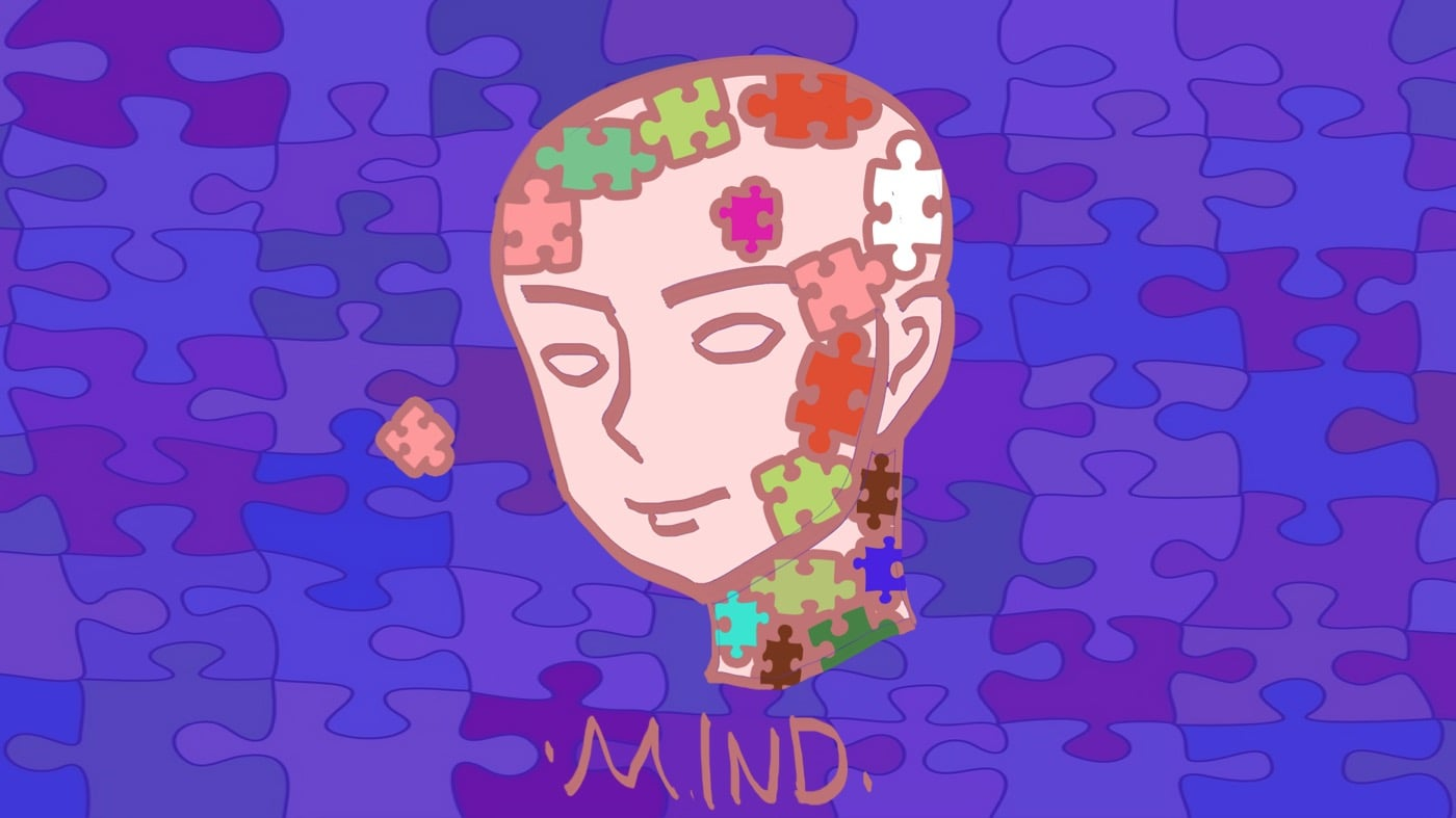 young brain with puzzle pieces representing mental fitness