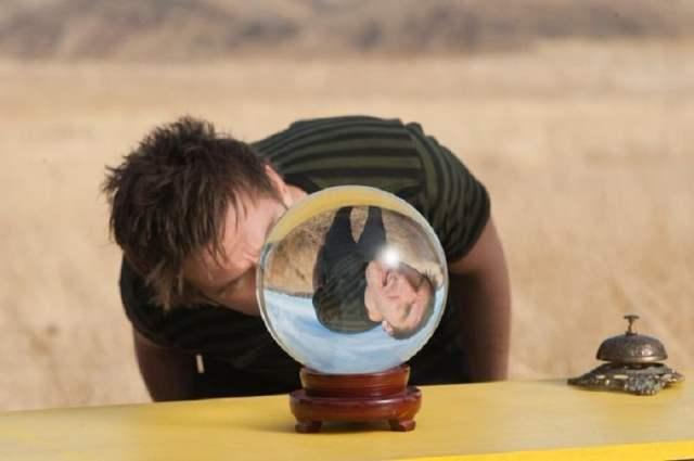 Dan Stevens as David Haller peering in a crystal ball