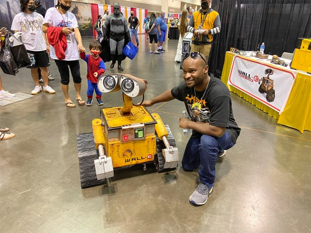 WALL-E from the Pixar Disney movie robot with convention attendee