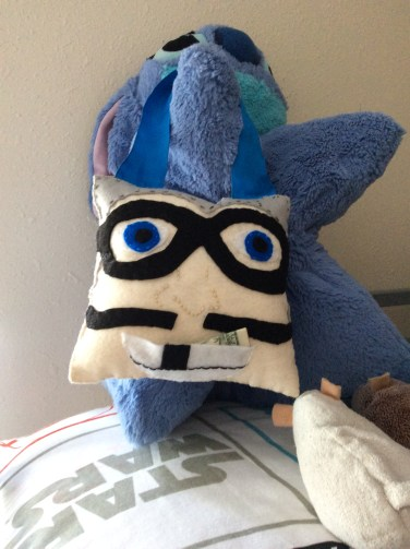 The Aquabats MC Bat Commander makes an excellent tooth fairy pillow! Make this craft with our free pattern! Geeknots.com!