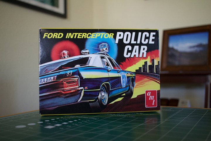 "The box for AMT's ""Ford Intercepter Police Car"" model kit."