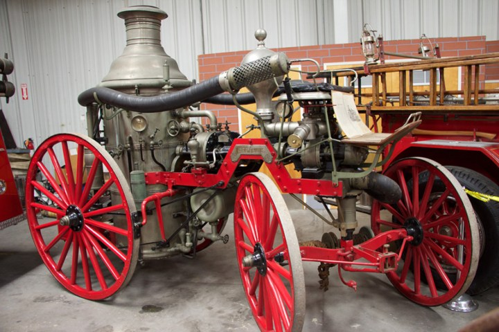 "An old, horse-drawn, steam fire engine, ""Neptune""."