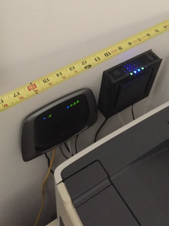 Linksys E2000 router and Motorola cable modem mounted on wall
