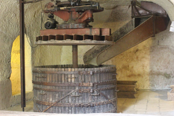 A press deep under Chateau de Breze.