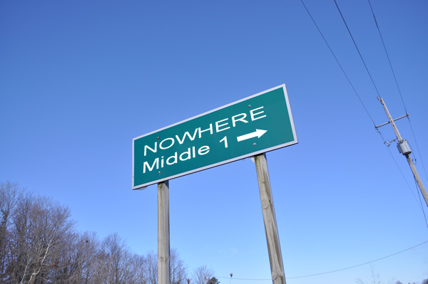 Road sign: NOWHERE. with Middle 1 and an arrow to the right on the second line.