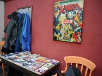 Our book and comic swap underneath an X-Men poster. Cool!