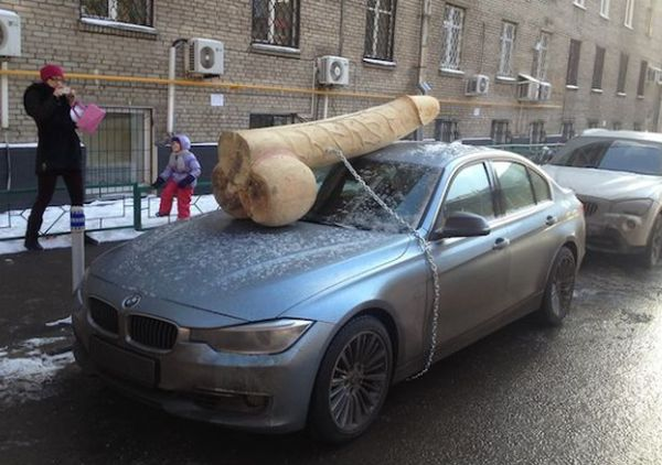 Putin Critic Surprised with 200-Pound Wooden Penis On BMW