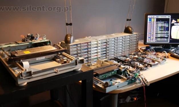 Orquesta de unidades de floppy disks, hard drives y escáners en una interpretación alucinante
