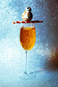 """The BB-8 Bellini"" - Anyone (or any droid) that can handle the harsh sands of Tatooine and keep on rolling needs a cocktail to match their scrappy, fun personality, and this orange treat does the trick! 4 oz chilled Prosecco DOC 1oz blood orange 1 oz white peach puree Pour the blood orange and white peach puree into a chilled flute and top with Prosecco DOC."
