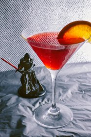 """Kylo Ren-tini"" - Are you still mourning the death of Darth Vader? Well don't worry — so is Kylo Ren. In fact, the only thing more bitter than him is this cocktail as red as his crossguard lightsaber. 1 oz Amaro Lucano 2 oz red wine 0.8 oz tonic water 0.5 oz sugar syrup Mix the drink directly in the martini glass and serve with a slice of lemon and orange, a sprig of mint, fruits of the forest and ice."