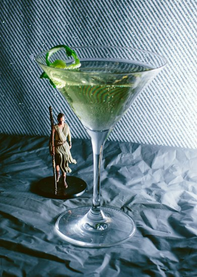 """Rey-tini"" - After dealing with all the wretched hives of scum and villainy on Jakku all day, someone like Rey needs to kick back and relax with a tequila martini that kicks as much butt as she does. 2 oz Partida Anejo 0.75 oz freshly squeezed lime juice 0.5 oz agave nectar 1 oz champagne Build all ingredients except the champagne add ice shake and strain into a martini glass. Top with one ounce of champagne and garnish with a long lime twist."