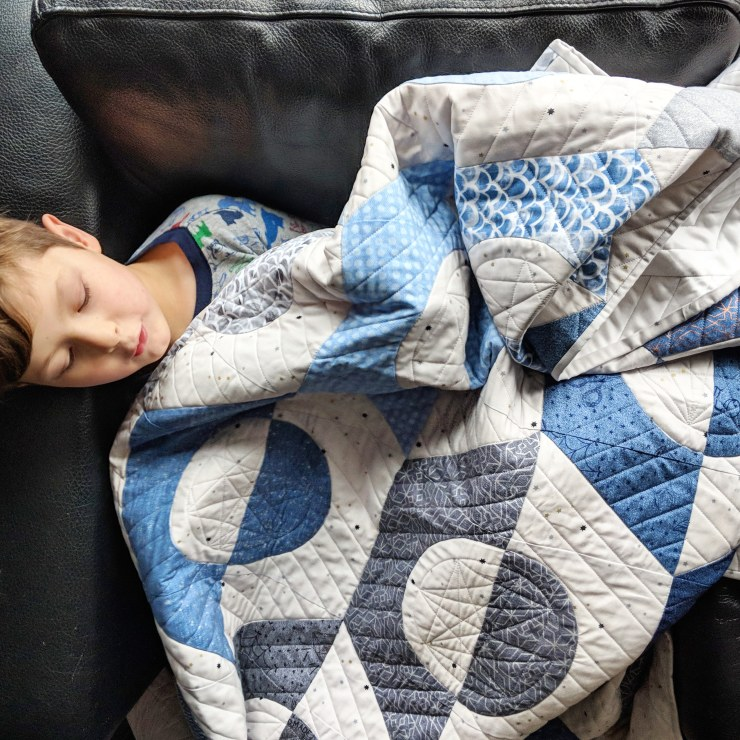 A perfect quilt for a boy. Riveting quilt pattern by geeky bobbin, in denim themed fabrics by Libs Elliott.