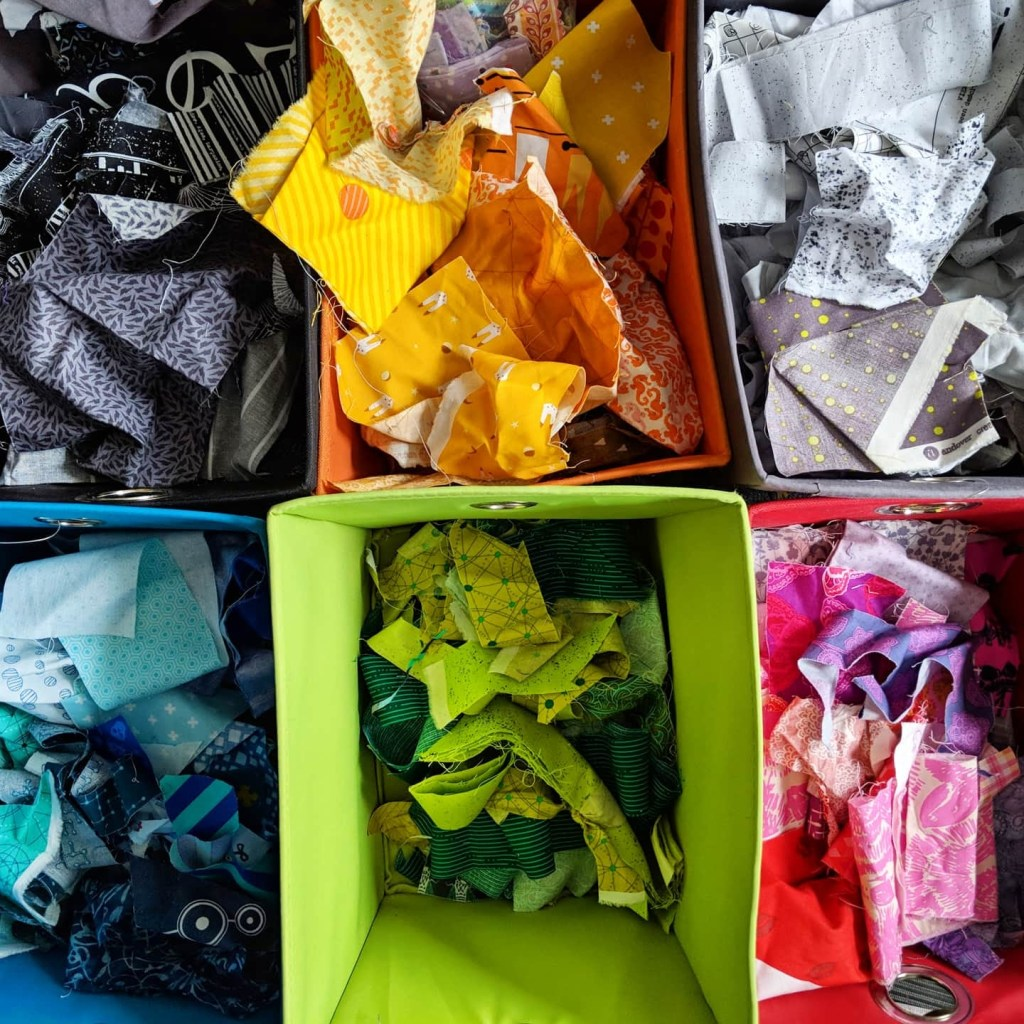 I sort my fabric scraps by color. My fabric storage system works for the way I work on quilts.