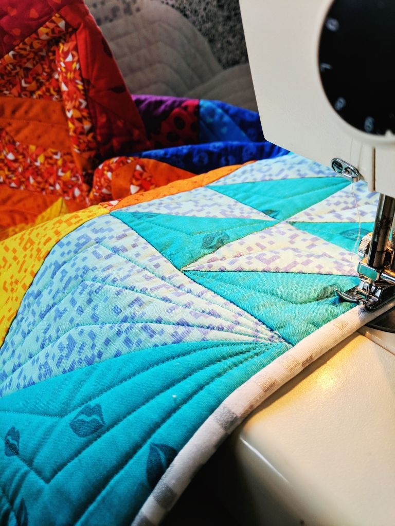 Finishing machine binding by stitching in the ditch from the front on the Retro Tetro quilt by Geeky Bobbin. Fabrics by Libs Elliott