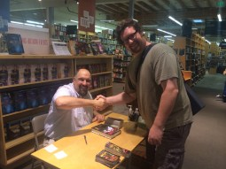 Larry Correia and GeekyLibrary Reviewer Taylor shaking hands at the book signing