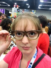 Trying on beautiful wooden glasses from Sire's Eyewear