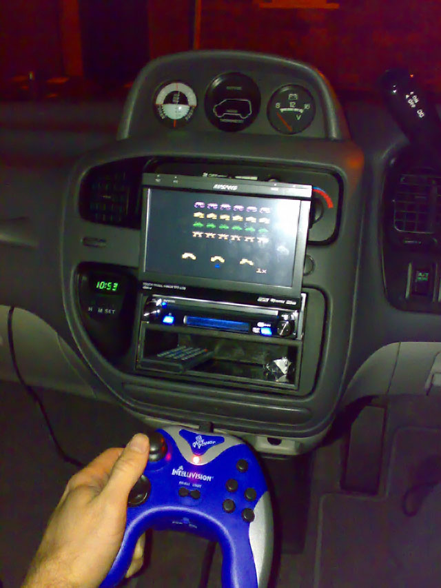Mitsubishi Delica L400 with Ripspeed DV920i in-dash DVD player and optional altimeter and compass pod.