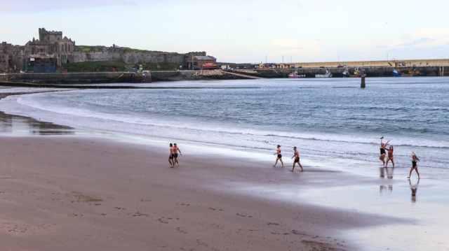Swimmers leaving the sea on Peel Beach