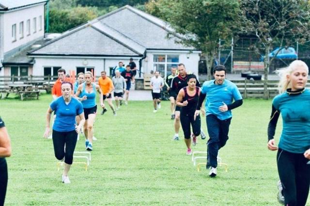 Members of the KUTA fitness class take part in circuit training