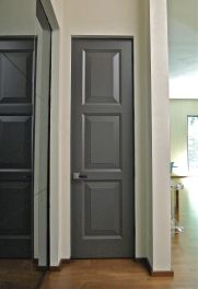 Eight foot tall custom panel doors, lacquered in deep grey, provide a sober transition between rooms. The leather wrapped nickel lever handle softens the experience.