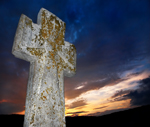 brightly lit stone cross